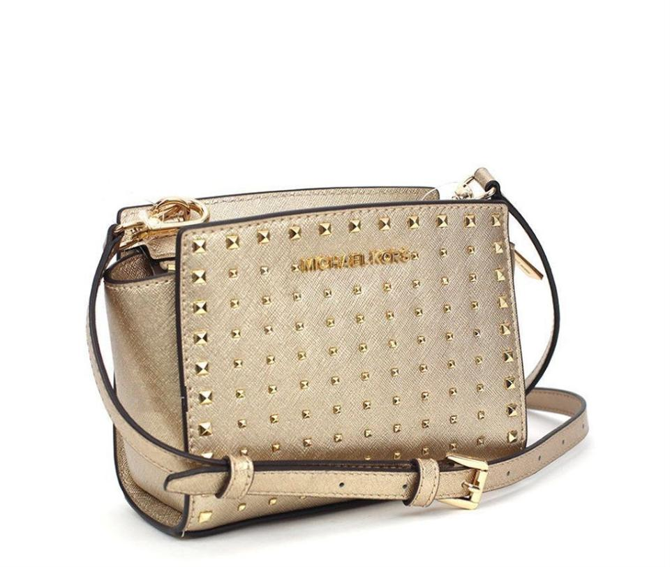 Michael Kors Selma Mini Stud Gold Leather Cross Body Bag - Tradesy 264126db1d079