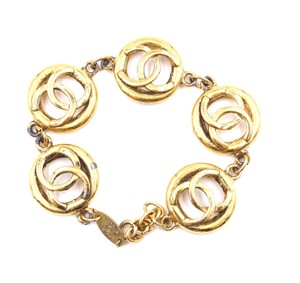 Chanel RARE CC Cutout medallion pendant charm Gold links bracelet cuff