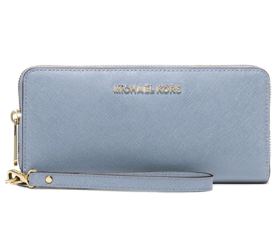 64a7a2a45153 Michael Kors Michael Kors Jet Set Travel Pale Blue Saffiano Continental  Wallet Image 0 ...