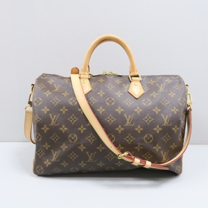 Louis Vuitton Lv Sdy 35 Monogram Bandouliere Canvas Satchel In Brown