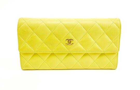 Preload https://img-static.tradesy.com/item/24660693/canary-yellow-quilted-leather-and-cc-logo-long-continental-mv-wallet-0-0-540-540.jpg