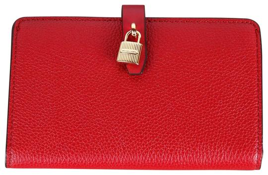 Preload https://img-static.tradesy.com/item/24670920/michael-kors-red-adele-slim-bifold-merlot-pebbled-leather-wallet-0-1-540-540.jpg