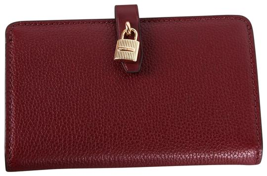 Preload https://img-static.tradesy.com/item/24670959/michael-kors-merlot-red-adele-slim-bifold-pebbled-leather-wallet-0-1-540-540.jpg