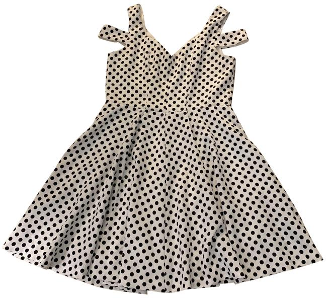 Preload https://img-static.tradesy.com/item/24674253/betsey-johnson-white-and-black-sleeveless-mid-length-short-casual-dress-size-12-l-0-1-650-650.jpg