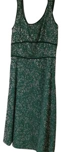 Anni Kuan short dress Green and a silvery color on Tradesy