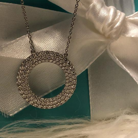 Tiffany & Co. Tiffany & Co. Metro Collection Necklace 18K White Gold open circle pendant set with a three-row of diamonds.