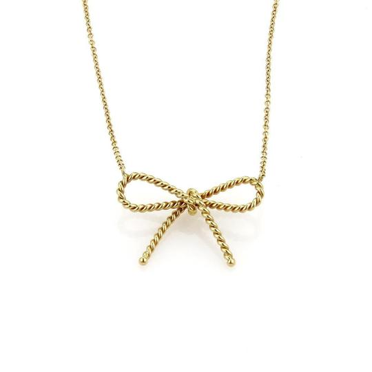 Preload https://img-static.tradesy.com/item/24695017/tiffany-and-co-59364-18k-yellow-gold-twisted-cable-wire-bow-pendant-chain-necklace-0-0-540-540.jpg