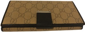 Gucci Tan and brown GG Plus canvas Gucci trifold wallet