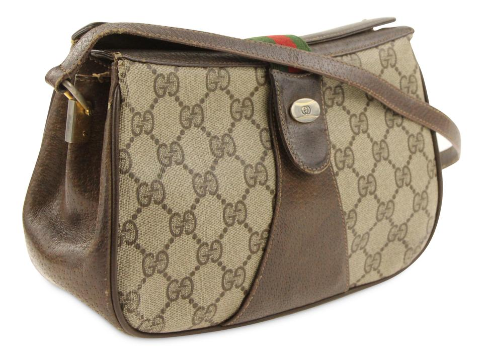 1ef28050d4e853 Gucci Fold Over Gg Brown Coated Canvas Shoulder Bag - Tradesy