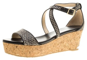 954ea66f98fe Black Jimmy Choo Sandals - Up to 90% off at Tradesy