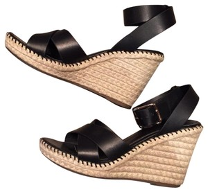 ALDO Black and Tan Wedges