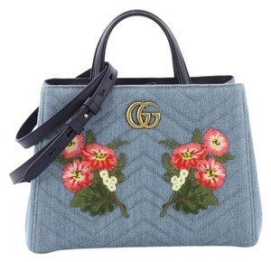 e2e84bc41ee3 Added to Shopping Bag. Gucci Denim Tote in blue. Gucci Marmont Embroidered Matelasse  Small ...