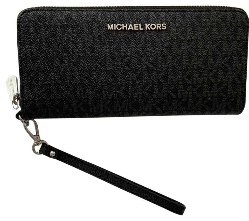 cd87be3e66fd1b Michael Kors Leather Silver Hardware Signature Wristlet in Black Image 0 ...