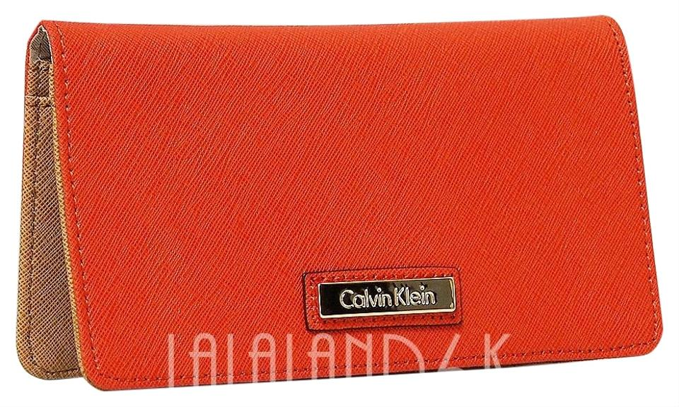 868466cc2569a7 Calvin Klein Orange Saffiano Leather Slim Wallet - Tradesy