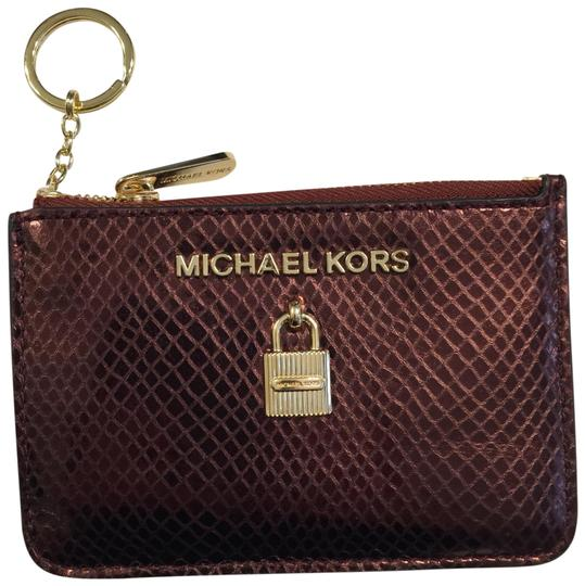 Preload https://img-static.tradesy.com/item/24728424/michael-michael-kors-merlot-adele-coin-pouch-with-id-embossed-leather-mini-wallet-0-1-540-540.jpg