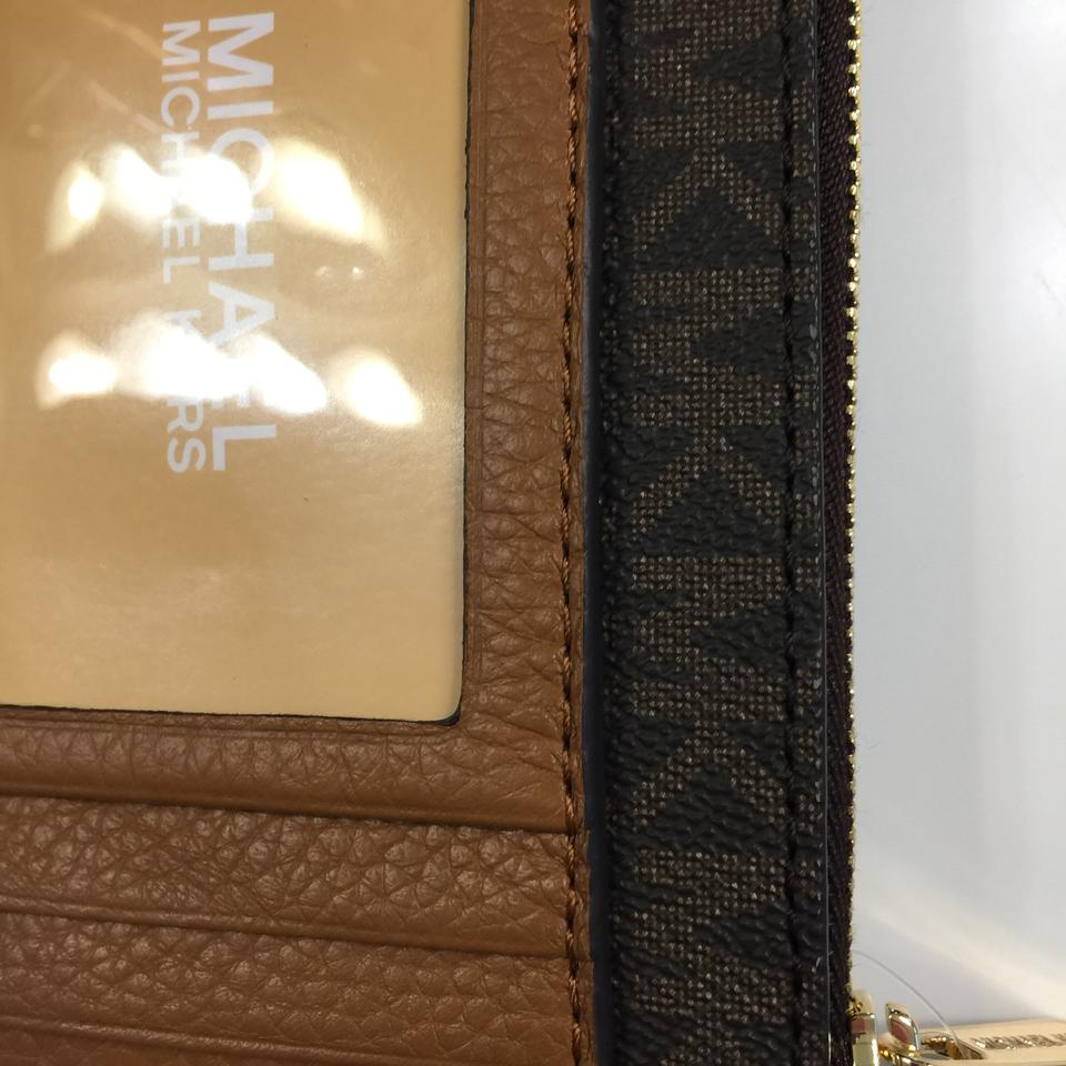 62eb9b9a7d4450 MICHAEL Michael Kors Fulton Brown Acorn Signature MK Coin Pouch w/ID  Leather Small Wallet. 12345678910