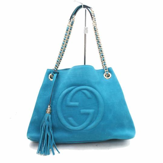 Preload https://img-static.tradesy.com/item/24729011/gucci-soho-fringe-tassel-chain-tote-869786-blue-nubuck-leather-shoulder-bag-0-0-540-540.jpg