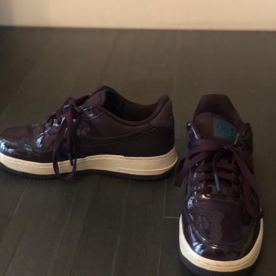 Nike deep purple with teal accents Athletic Image 1