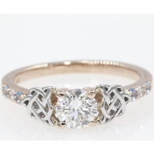 14k Rose Gold .65 Carat Round Cut Side Stone with Blue Topaz Engagement Ring
