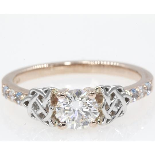 Preload https://img-static.tradesy.com/item/24729846/14k-rose-gold-65-carat-round-cut-side-stone-with-blue-topaz-engagement-ring-0-0-540-540.jpg