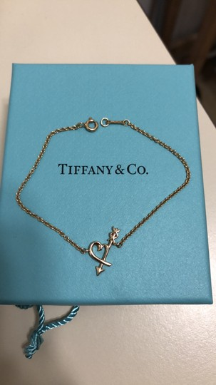 Tiffany & Co. Tiffany & co gold heart cupid bracelet Image 1