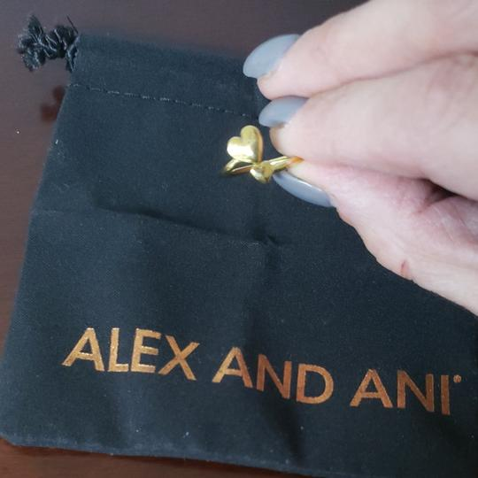 Preload https://img-static.tradesy.com/item/24738811/alex-and-ani-gold-tone-adjustable-double-heart-perfect-gift-for-valentine-s-day-ring-0-0-540-540.jpg