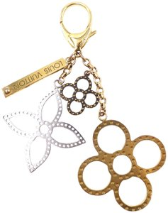 Louis Vuitton monogram large textured cutout gold key charms ring chain