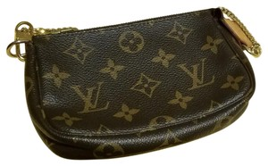 Louis Vuitton Wristlet in Mongram