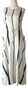 white with vertical black stripes Maxi Dress by Lou And Grey