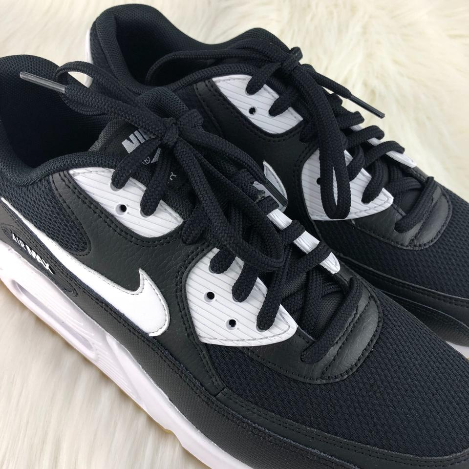 low priced 30403 c15a4 Nike Black Women s Air Max 90 Sneakers. Leather and Mesh Upper ...