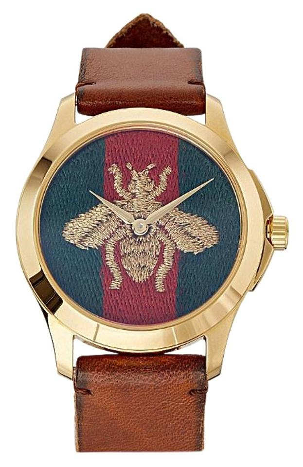 66076b855 Gucci YA126451 G Timeless gold-plated stainless steel watch Image 0 ...