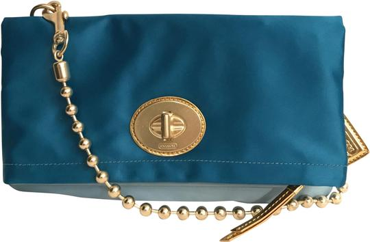 Preload https://img-static.tradesy.com/item/24751931/coach-new-ama-fldov-flap-12926-clutch-blue-gold-satin-shoulder-bag-0-1-540-540.jpg
