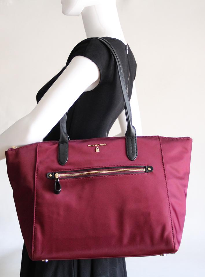 7f6c85cbf55be6 Michael Kors Travel Kelsey Nylon Plum Tote in Purple Image 11.  123456789101112
