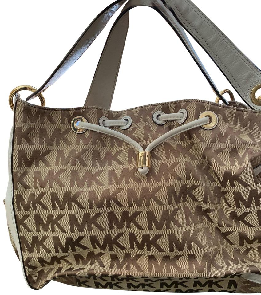 a1975e850fba Michael Kors Monogram Tan and White Canvas with Leather Trim Tote ...
