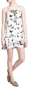 The Kooples short dress Cream Silk Butterfly Print Lace-up Flounce on Tradesy