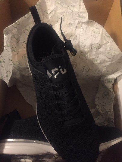 A.P.L. Sneakers Athleisure Running Sporty Chic Black w. White Sole and Silver Accent Athletic Image 1