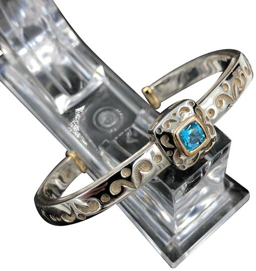Preload https://img-static.tradesy.com/item/24778386/blue-yellow-gold-and-silver-75-carat-topaz-carved-design-open-cuff-bangle-bracelet-0-1-540-540.jpg