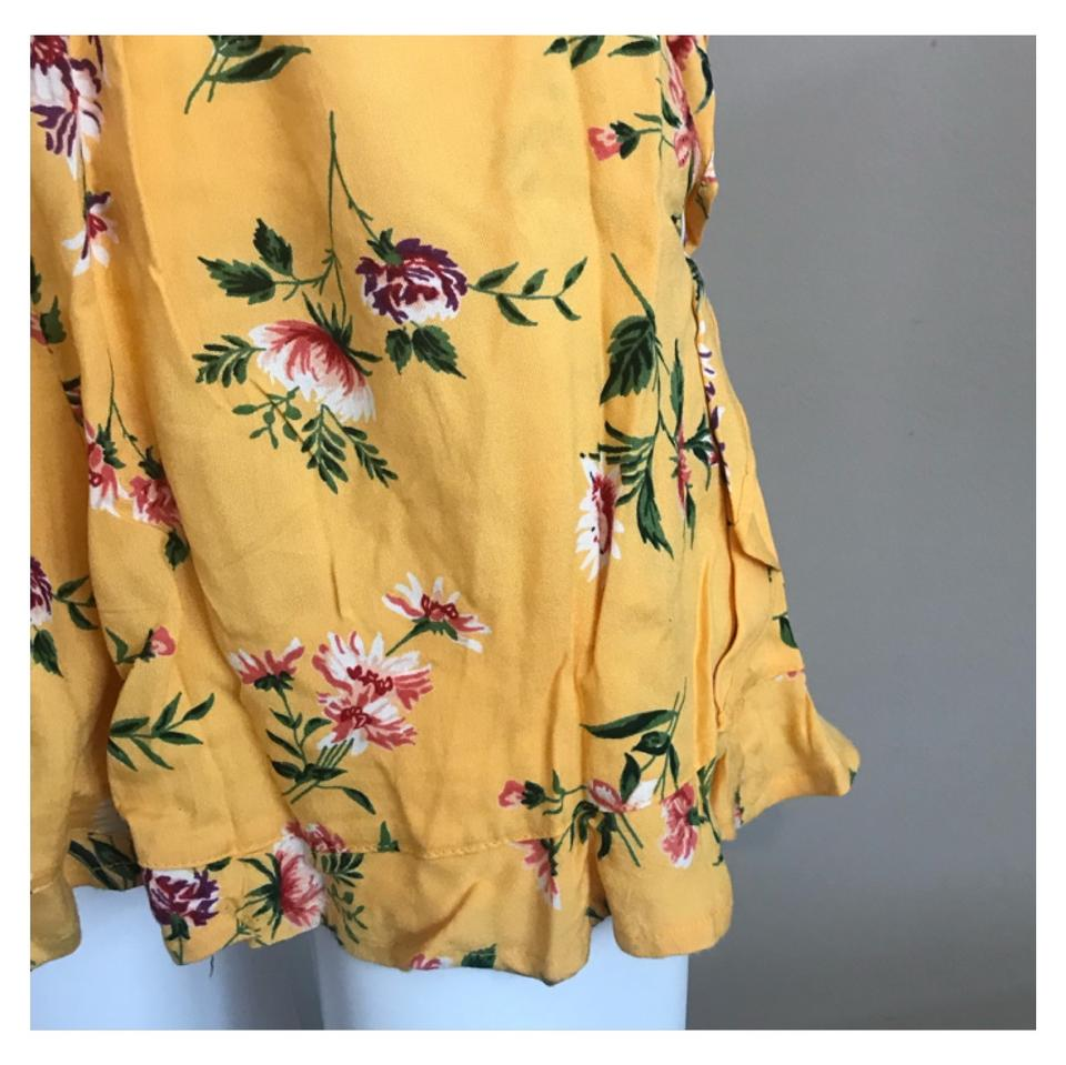 2664974116da Angie Yellow Smocked Waist Floral Print Romper Jumpsuit - Tradesy