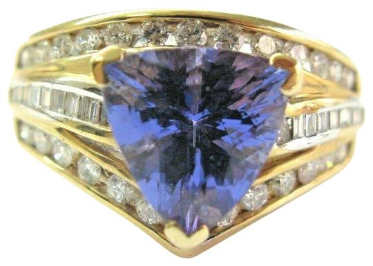 Preload https://img-static.tradesy.com/item/24782136/blue-natural-trillion-tanzanite-and-multi-shape-diamond-yellow-gold-334-ring-0-1-540-540.jpg