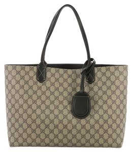 4a397001de0 Added to Shopping Bag. Gucci Leather Tote in brown and black. Gucci  Reversible Gg Print Large ...