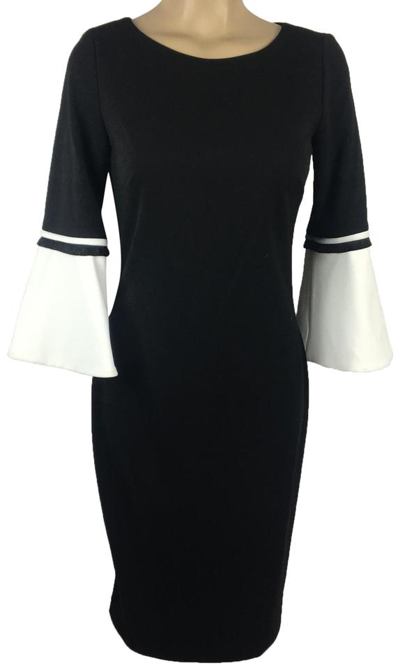 c83f72bd3ef8 Calvin Klein Black   White Bell Sleeve Night Out Dress. Size  2 (XS) Length   Mid-Length ...