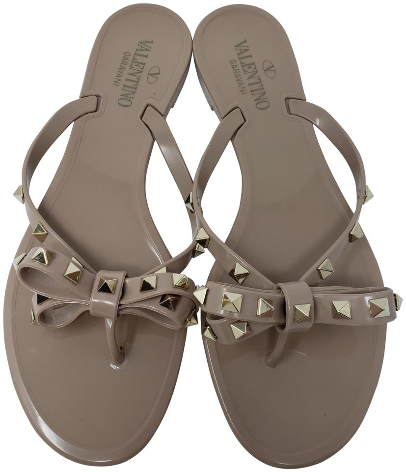 218c4f4a63ac Valentino Rockstud Gold Hardware Jelly Bow Studded Beige Sandals Image 0 ...