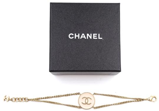 Chanel CC pink enamel plated disc gold chain bracelet cuff