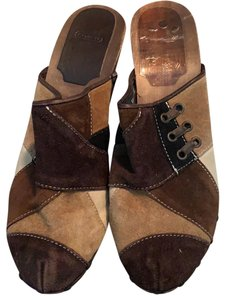 Coach browns and beiges. distressed wood heels Mules