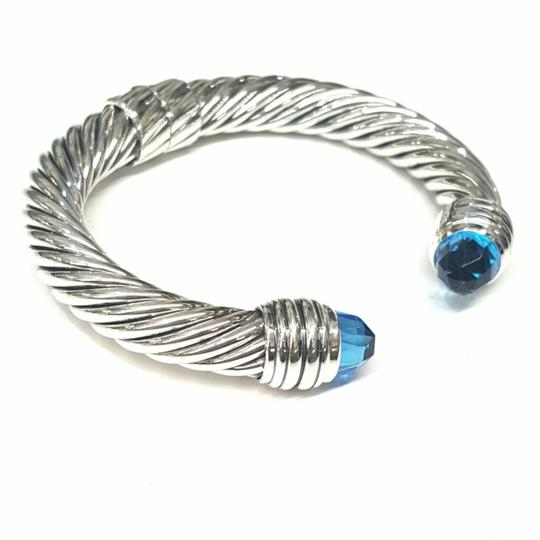Preload https://img-static.tradesy.com/item/24796911/david-yurman-sterling-silver-blue-topaz-10mm-hinged-cable-cuff-bracelet-0-2-540-540.jpg