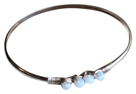 Preload https://img-static.tradesy.com/item/24797129/silverred-mexico-sterling-chalcedony-wire-wrapped-bangle-bracelet-0-2-540-540.jpg