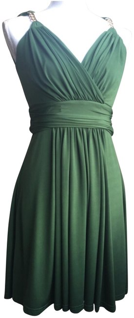 Preload https://img-static.tradesy.com/item/24803020/green-flowing-strappy-short-casual-dress-size-6-s-0-1-650-650.jpg