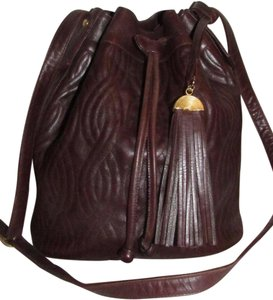 Fendi Mint Vintage Rare Early Cross Body/Shoulder Drawstring/Bucket Satchel in brown quilted leather in a 'pasta' or 'noodle' design and smooth brown leather