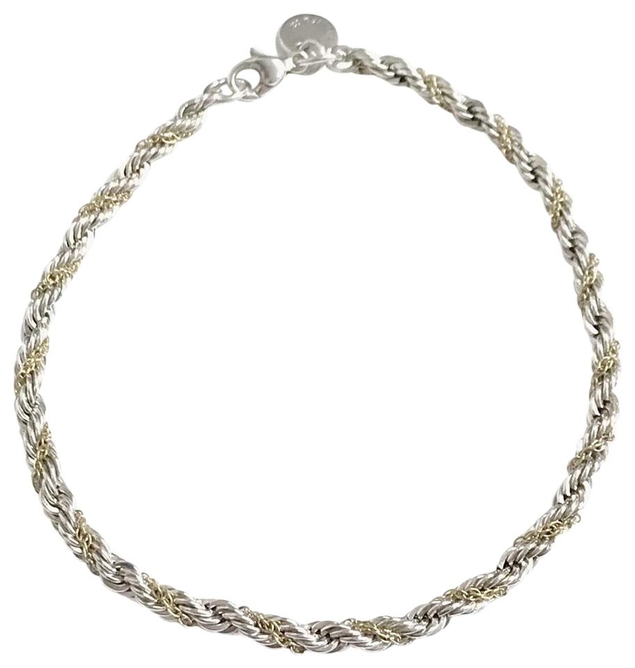 87fd44e2c Tiffany & Co. Twist 18 Karat Yellow Gold and Silver Rope Bracelet ...