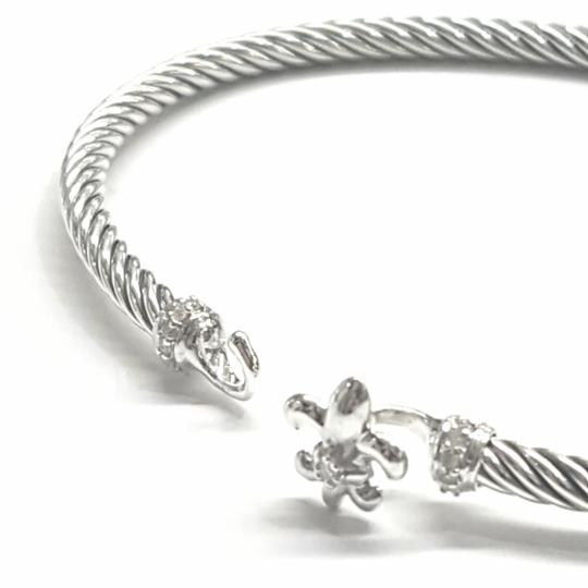 David Yurman NEVER WORN!! David Yurman Sterling Silver Fleur-de-Lis Bracelet with Pavé Diamonds 3mm Sterling Silver Pavé Diamonds Fits up to 7